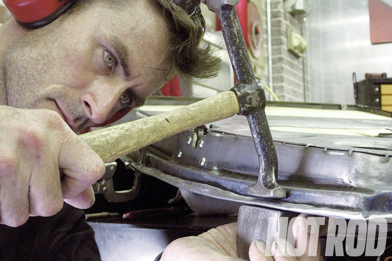 Bryan Fuller, of Fuller Hot Rods, folds over the door skin with a body hammer and dolly. Most of the 15 fabricators we're featuring are skilled at body fab, welding, and general design.
