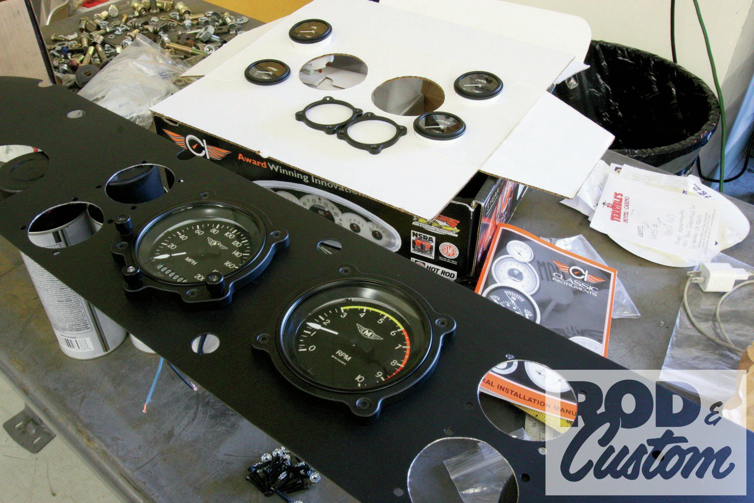 2. We showed you how to use a holesaw and drum sander to install gauges last month. As can be seen by the gauges in the background, the bezels for the Bomber Series gauges are separate, and require bolting through the dash, using the star bolts supplied. While the bezels will prevent the gauges from falling out, they won't stop them from turning, so the clamps on the rear are still required.