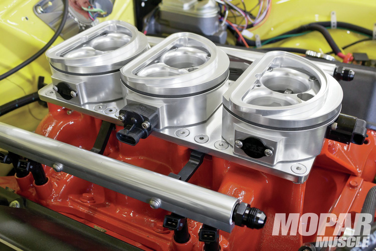 10 F&B custom spacers match the air cleaner base openings, and raise the Shaker scoop back to factory height.
