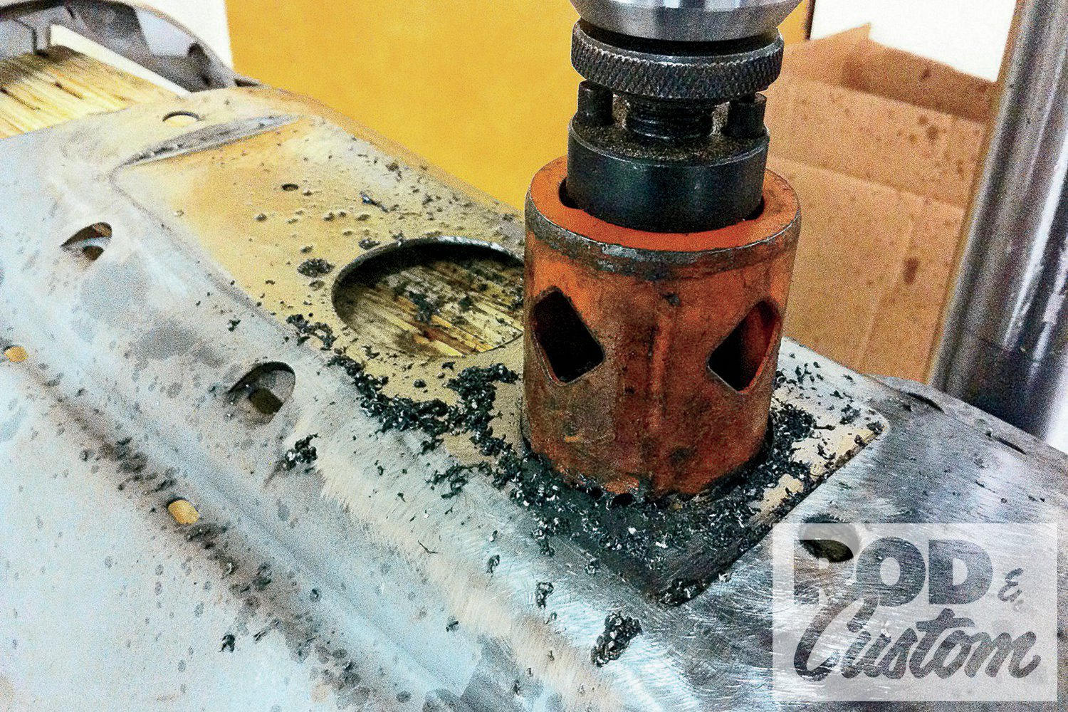 A holesaw in a drill press was used to cut out the gauge holes, with a block of wood behind the dash.
