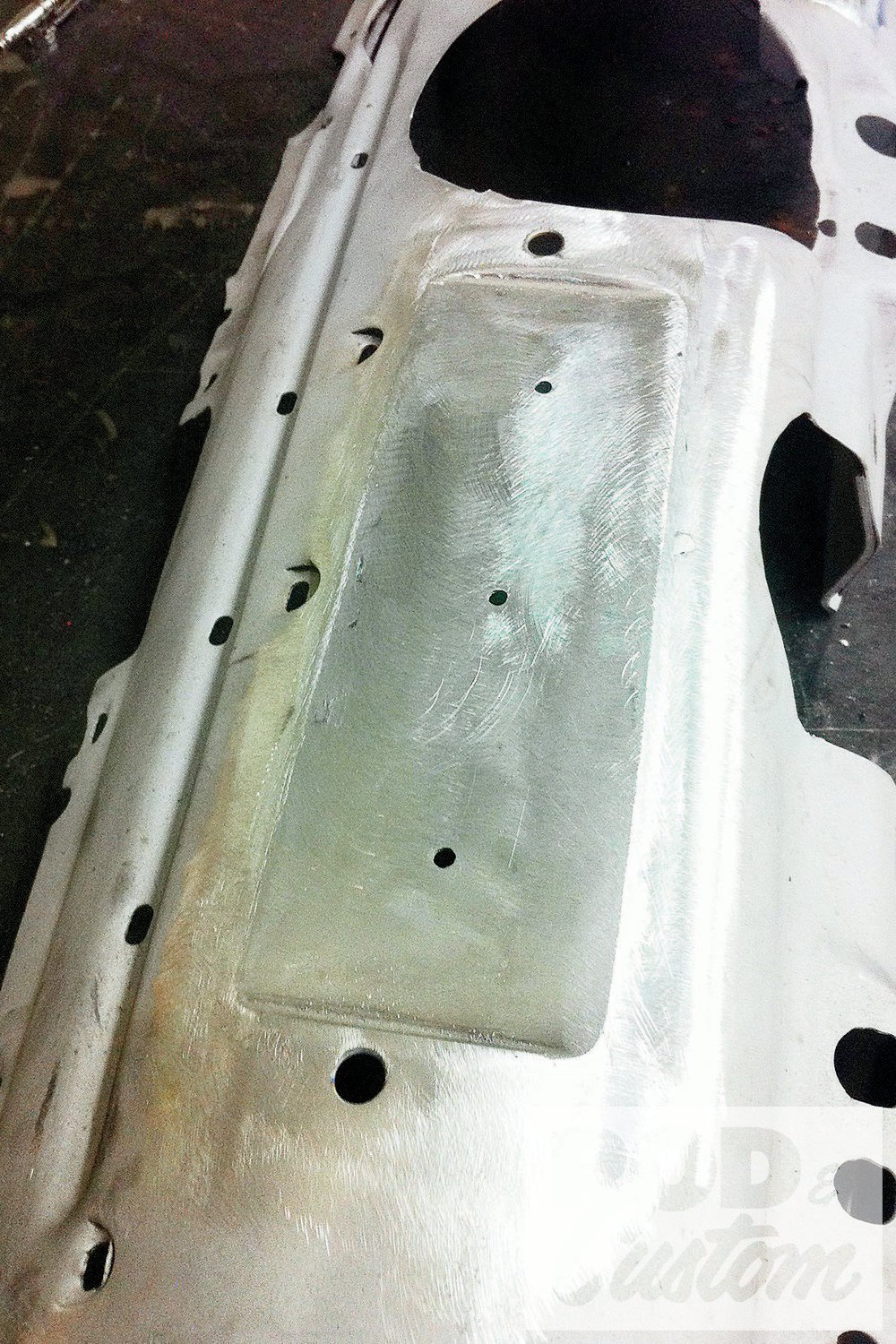 This flat section was welded in place with pilot holes drilled for the center of the gauges, as it's easier to lay out and drill these first.