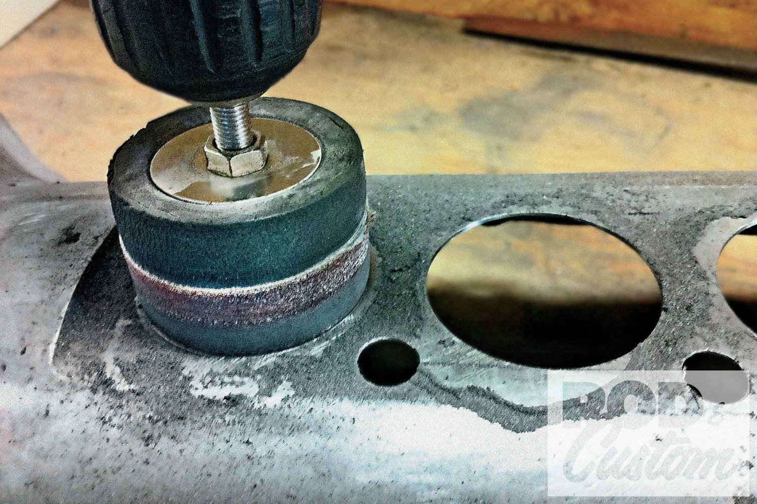 A drum sander was used to slightly enlarge the holes until each gauge was a press fit.