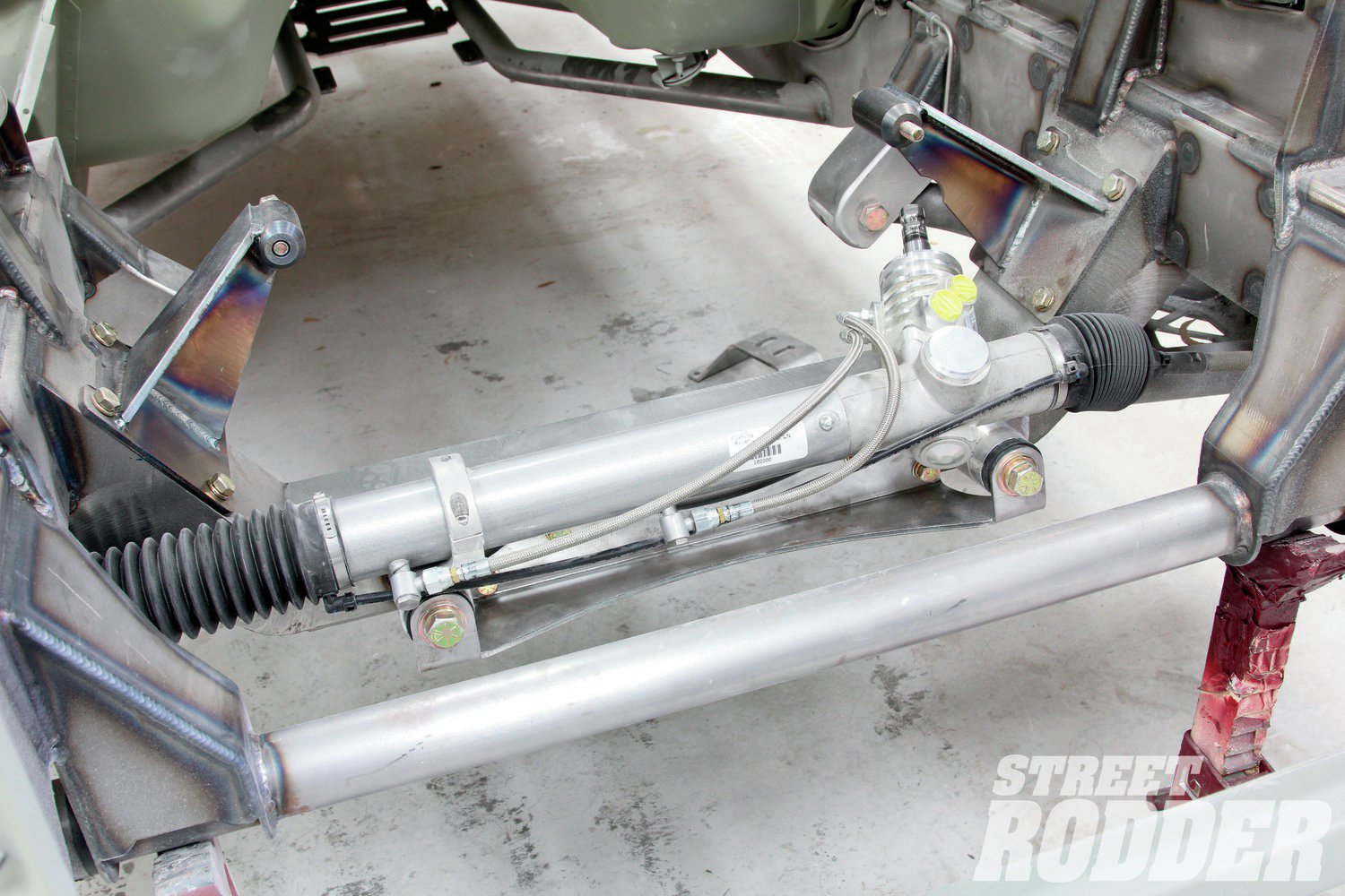 13. We used a Billet power steering rack from Flaming River. Made from all-new components, including a new valve and piston, these racks provide over 6 inches of travel.