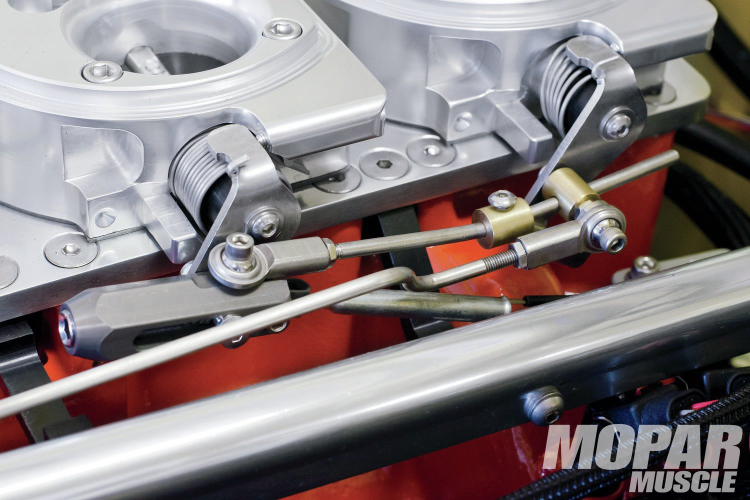 07 One of the really cool features of this system is the F&B designed fully adjustable progressive throttle linkage. The outboard throttles can stay closed until the center throttle has reached as much as 35-percent of its rotation.