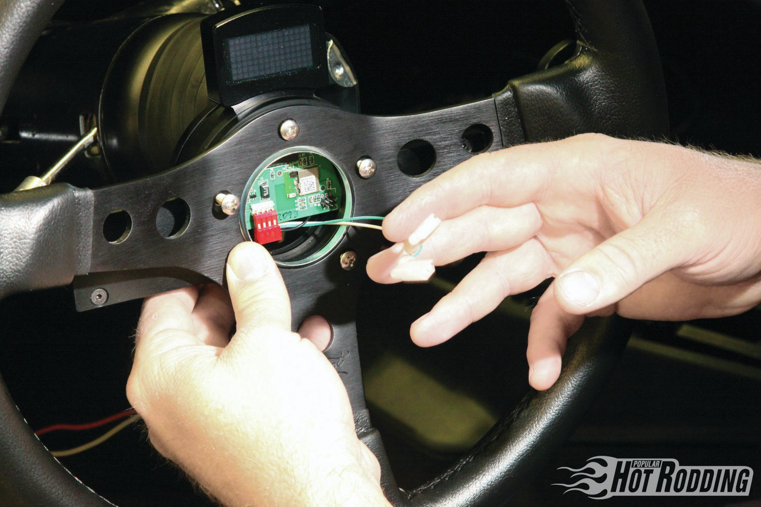 13. This small harness attaches to the old horn power wire and plugs into the paddle shifter circuit board via a small four-pin connector. Make sure not to bend the pins, a gentle touch works best. The last two spade connectors connect to the horn button and ground.