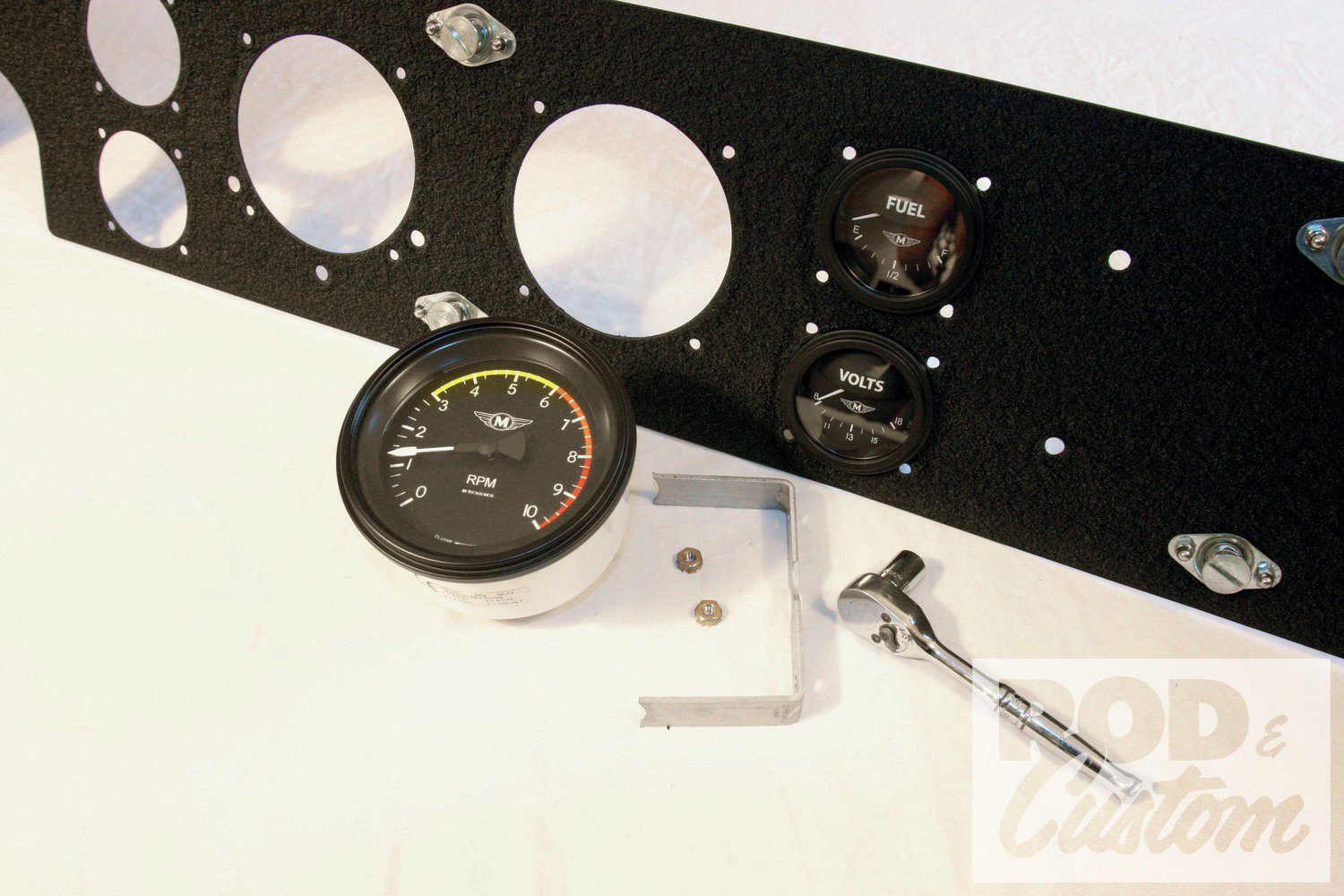 7. The dash going together for the final time. Each gauge has an aluminum clamp. Note also the four holes around each gauge hole for the bezels. The speedo has three extra holes for warning lights.