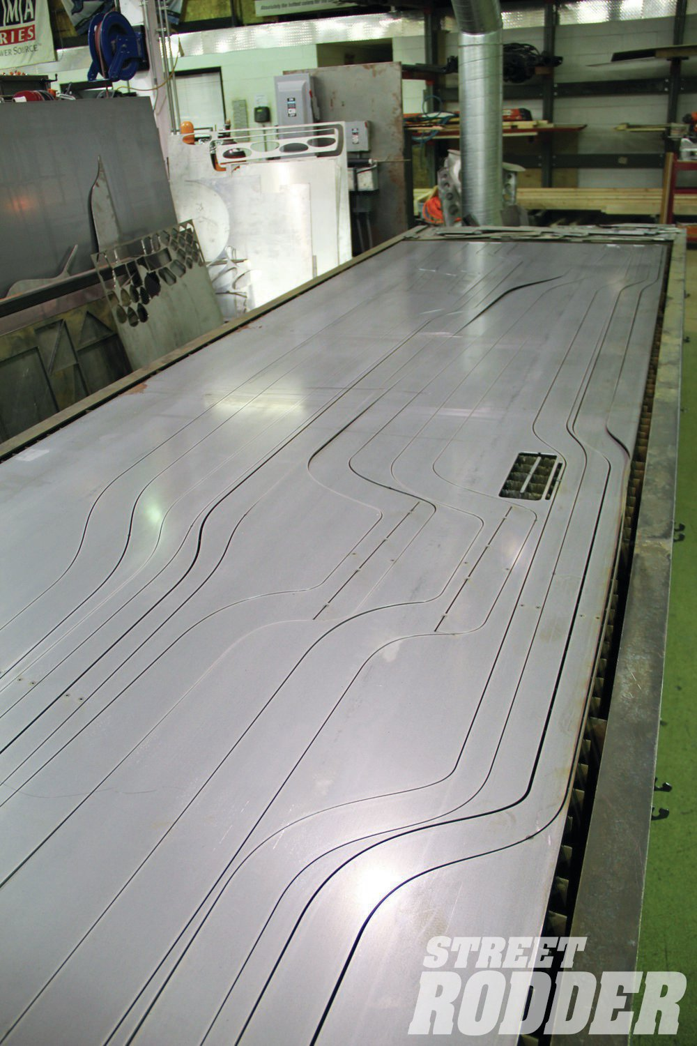 2. Using a laser the full-length pieces of the framerails are cut from a sheet of 10-gauge cold rolled steel.