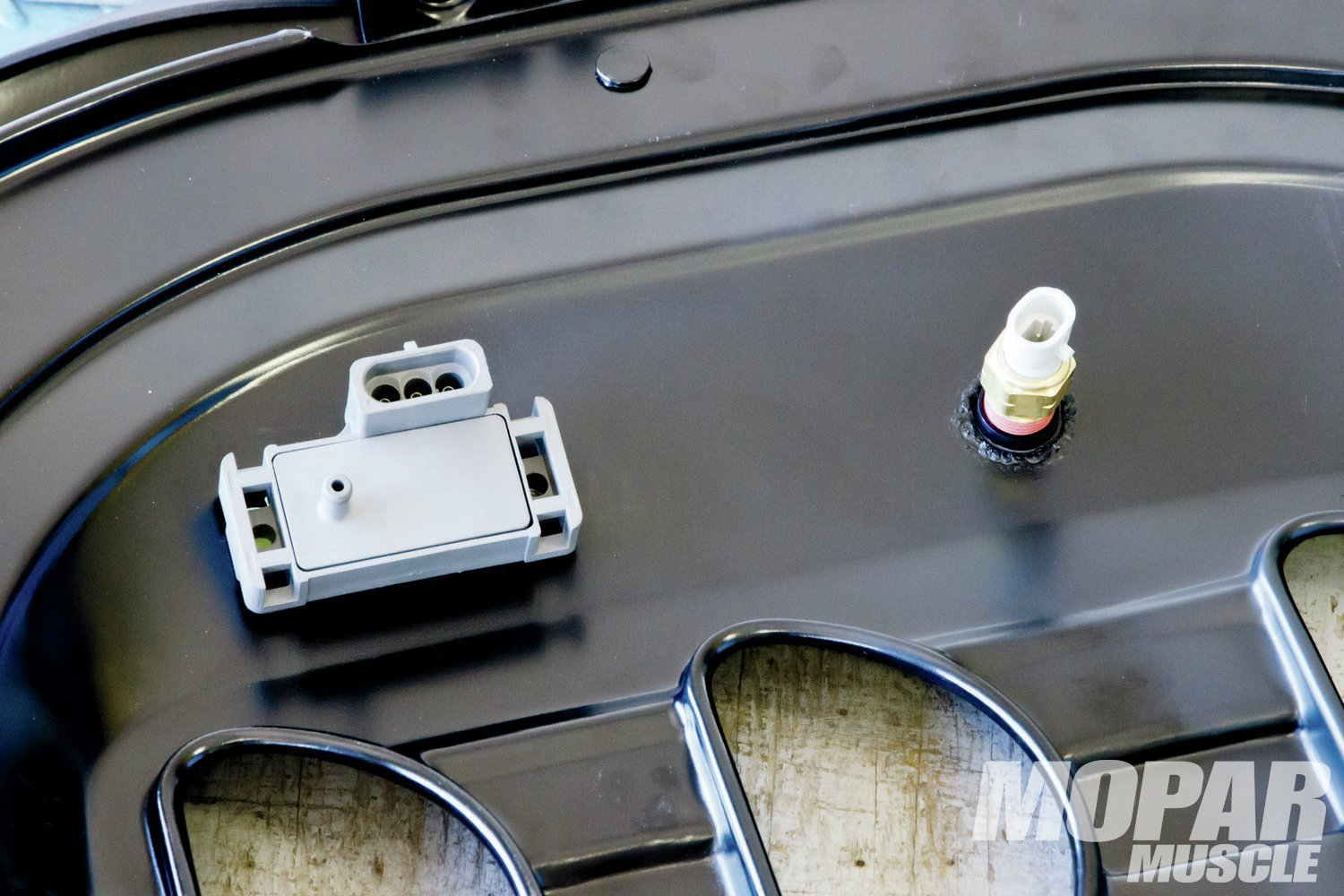 09 In this application, the MAP and air temp sensors are mounted under the air cleaner base.