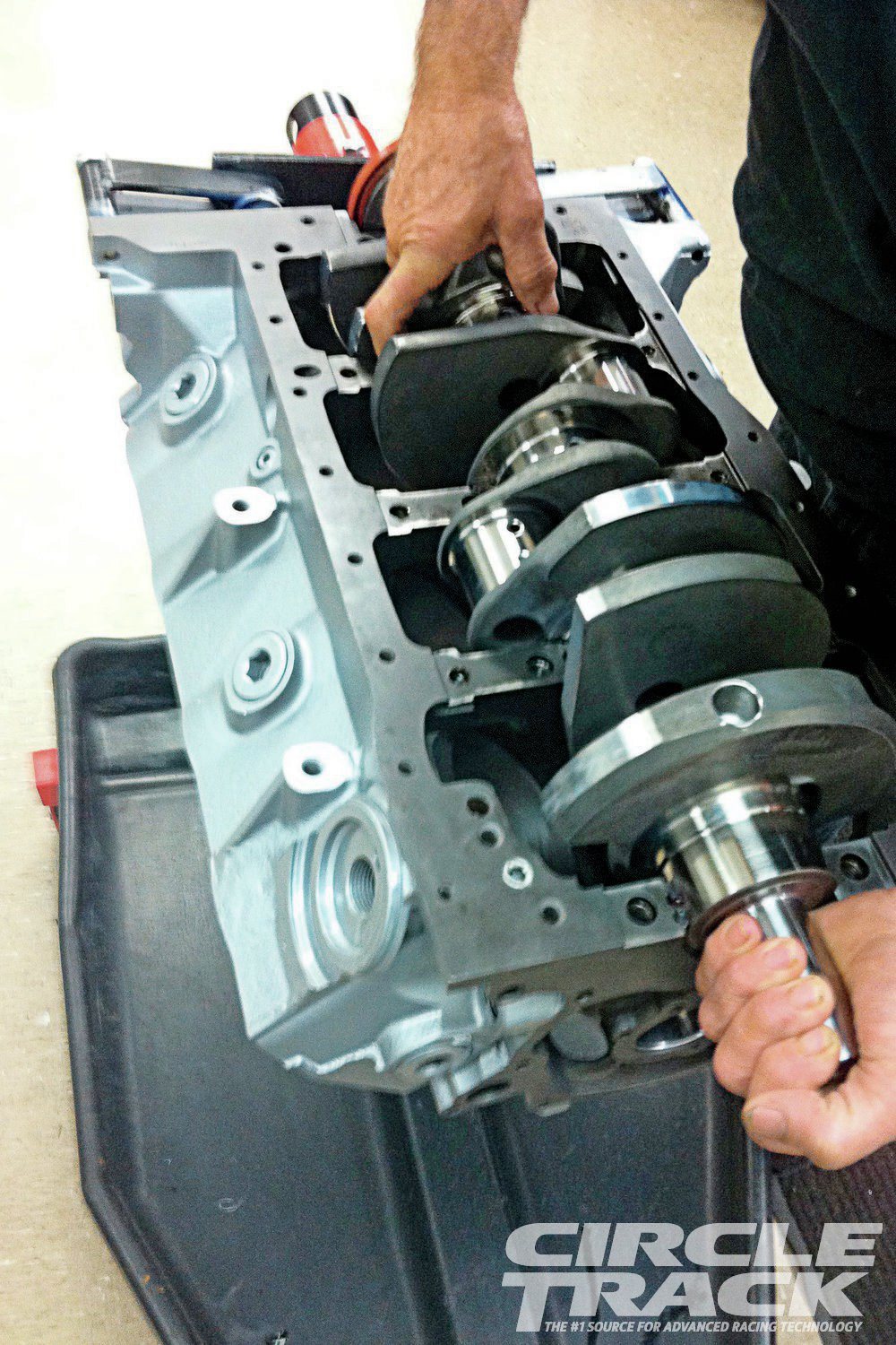 3. The SCAT crankshaft is laid into the block. The 9.2-inch deck height block, combined with the 3.75-inch stroke and 4.030-inch bore brings the displacement to 383ci.