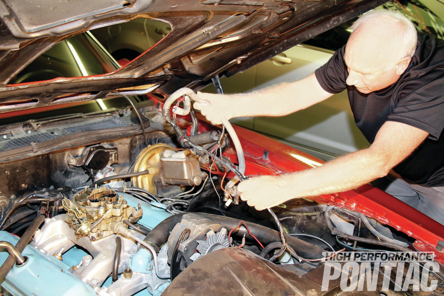 13. After snaking the wires through the spark-plug wires and vacuum hose, the entire engine harness simply lifts away.