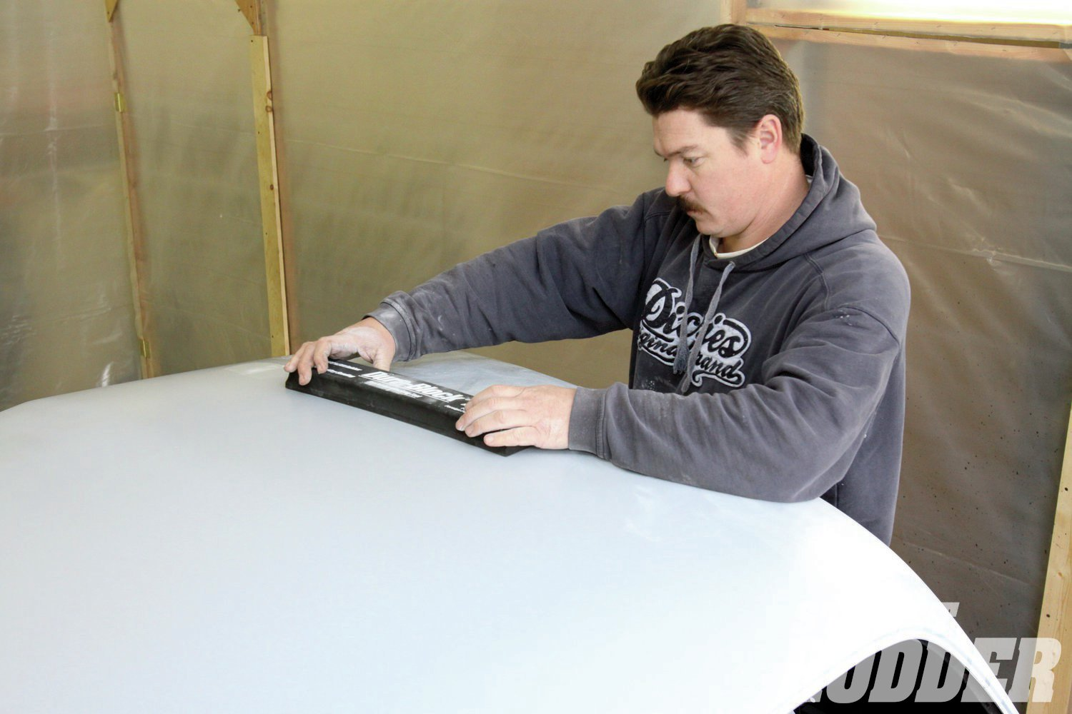 7. While the Plymouth's top looked good, Brazille's block sanding technique revealed signs of work done at some time in the coupe's past.