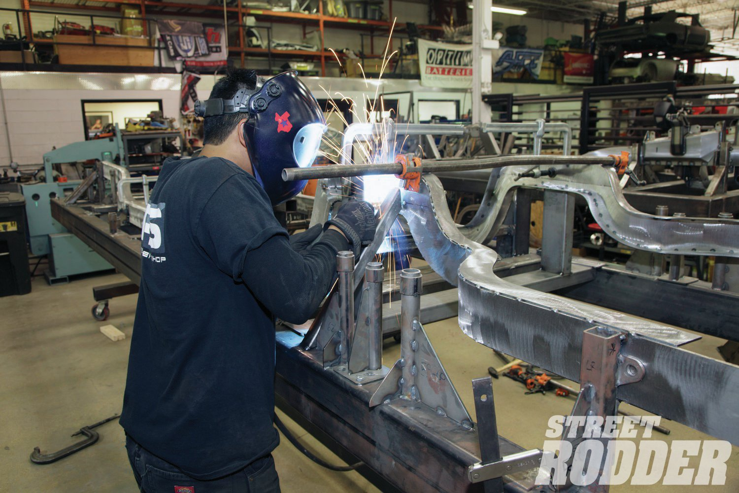 3. Zach Flores begins welding the 'rails together. By fabricating the frame out of separate pieces the complicated contours required to fit a perimeter frame under '58-64 Chevys without extensive floor modifications can be created.