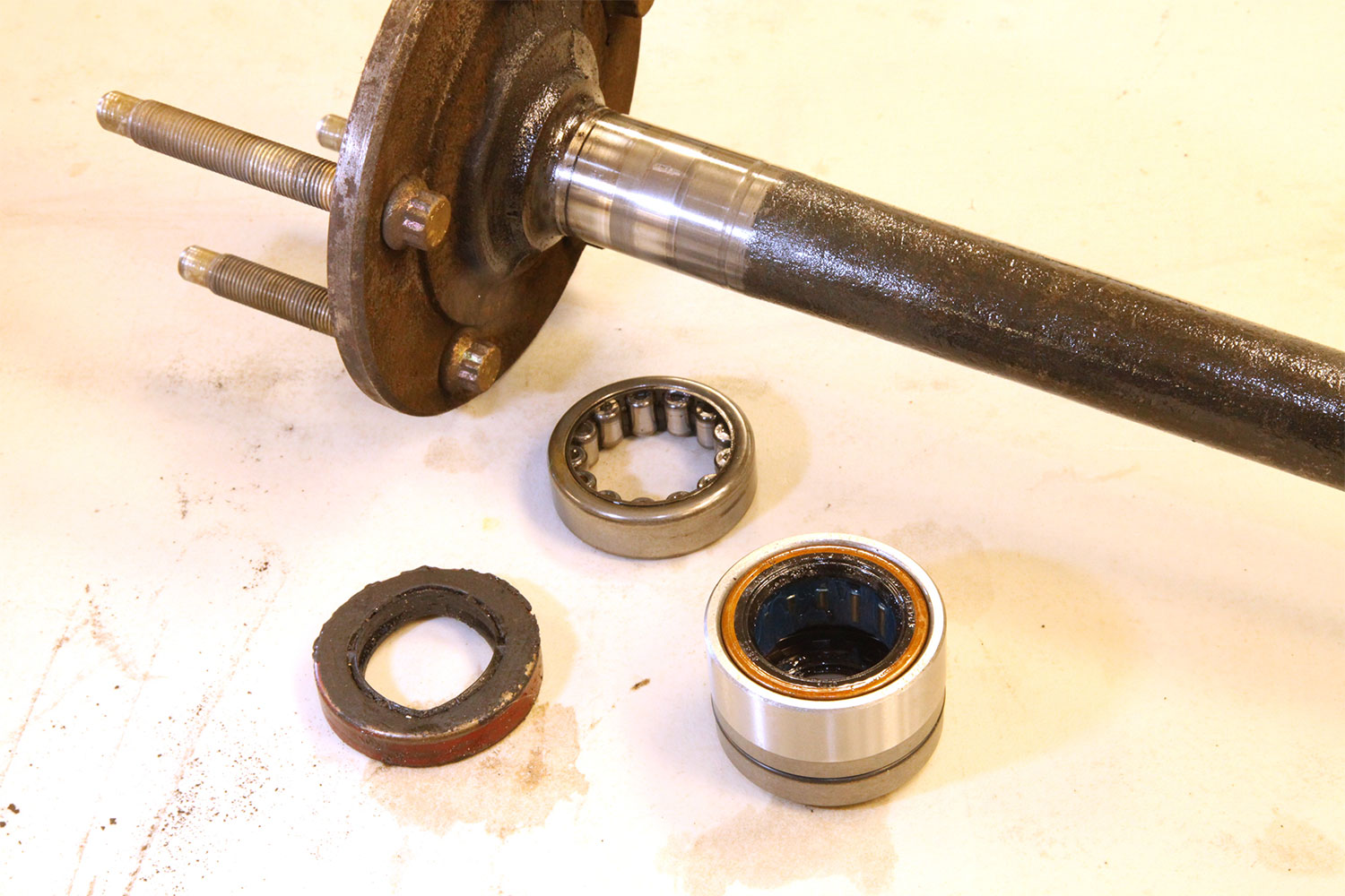 The 8.5-inch GM 10-bolt rear employs separate axle bearings and seals (left). Timken's replacement unit (right) performs both tasks in one unit and moves the bearing wear surface outward to a virgin area on the machined section of the axle.