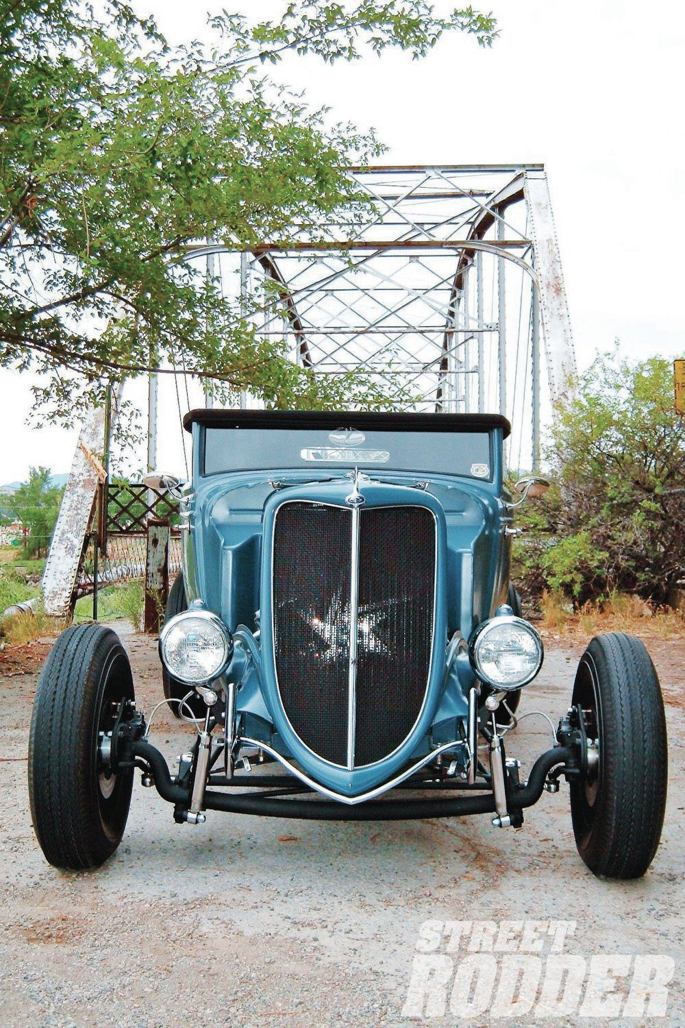 The grille used to be a mangled original, but Lane removed the ribs, straightened the perimeter, and added tabs to the inside edge of the grille so he could attach a stainless steel mesh insert he had made, adding the center bar afterward.