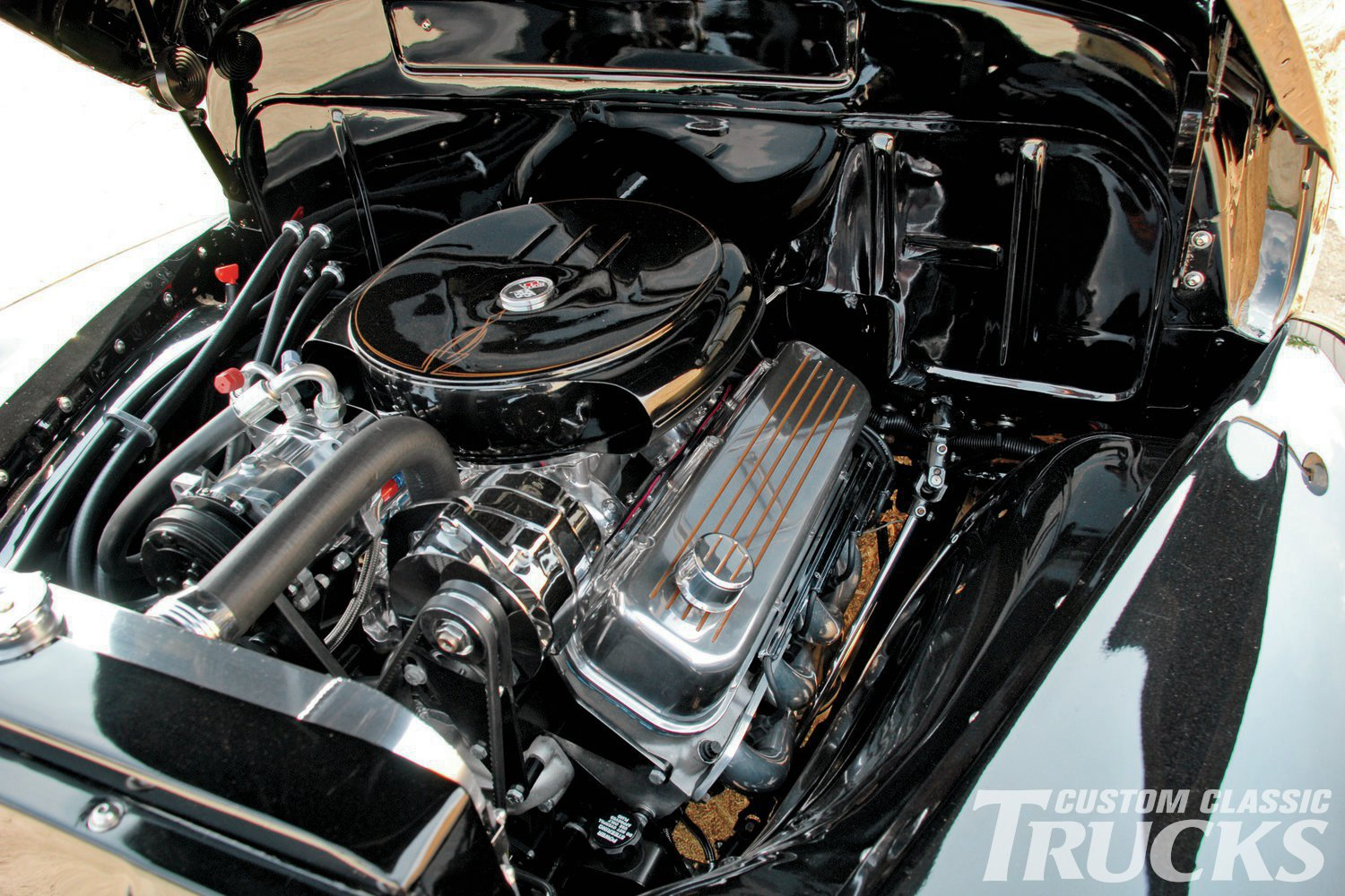 With such a conservative outward appearance many people are shocked to find a potent 496ci Chevy under the hood. The firewall has been smoothed and a vintage-style air breather keeps the clean and simple theme going.