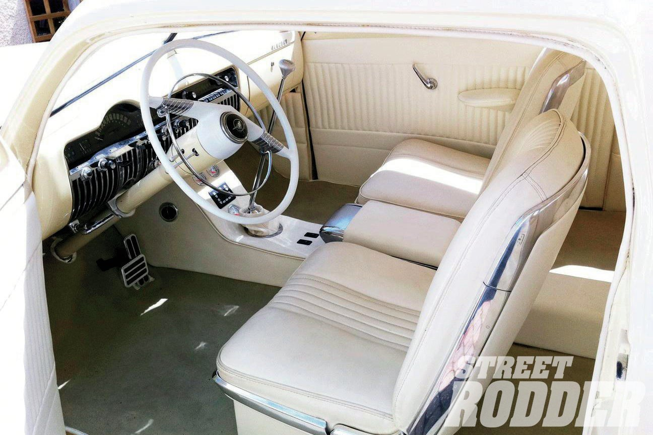 The interior of Teri's ride uses the bucket seats and center console from a '64 Thunderbird. Gary Kybert of Car Interiors stitched up the pleated vinyl that covers the two-tone interior.