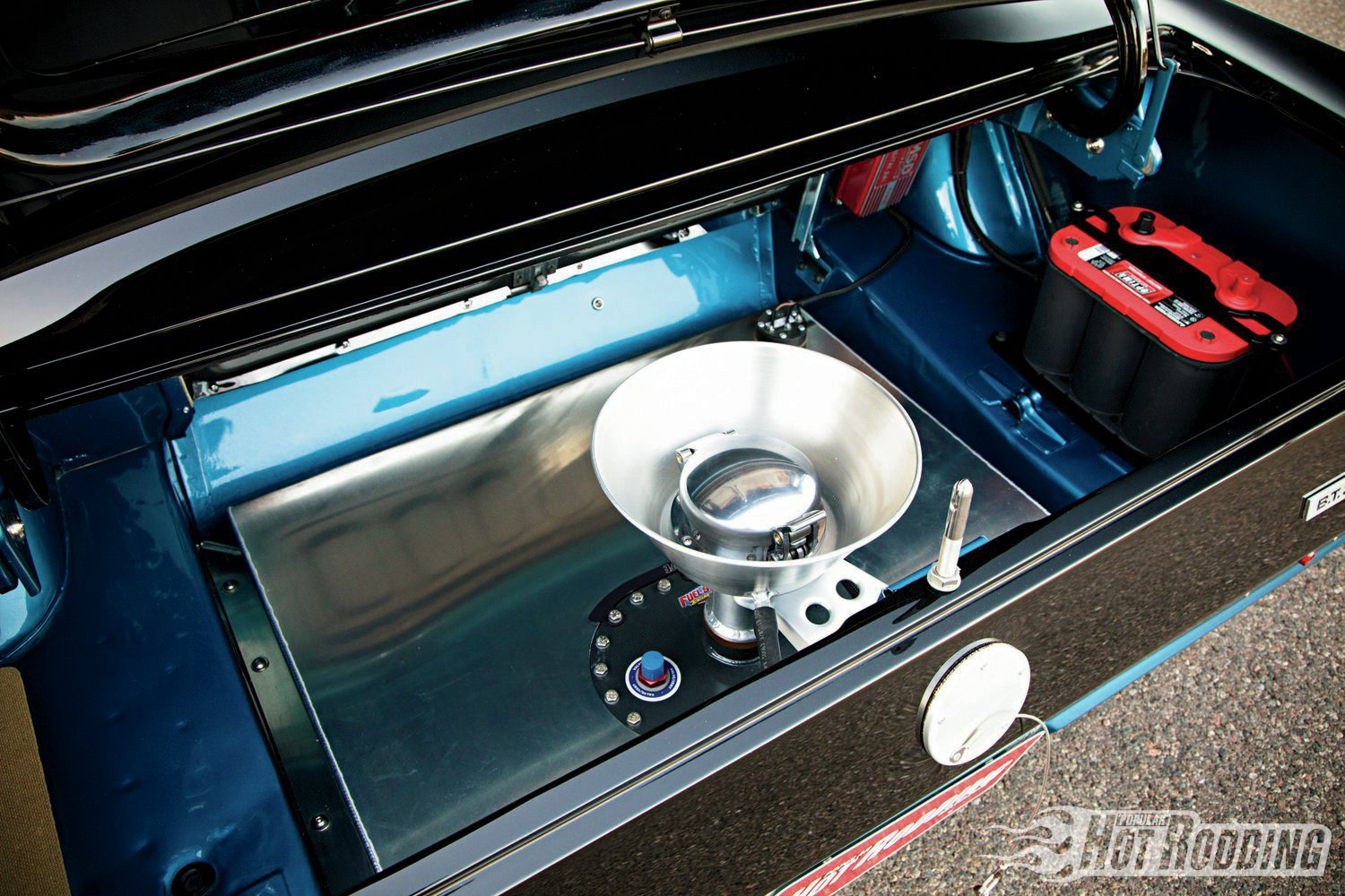 Road racers have big fuel cells, and the Mustang's 22-gallon Fuel Safe unit is no exception. It's been fashioned with a Shelby R-style splash bucket.