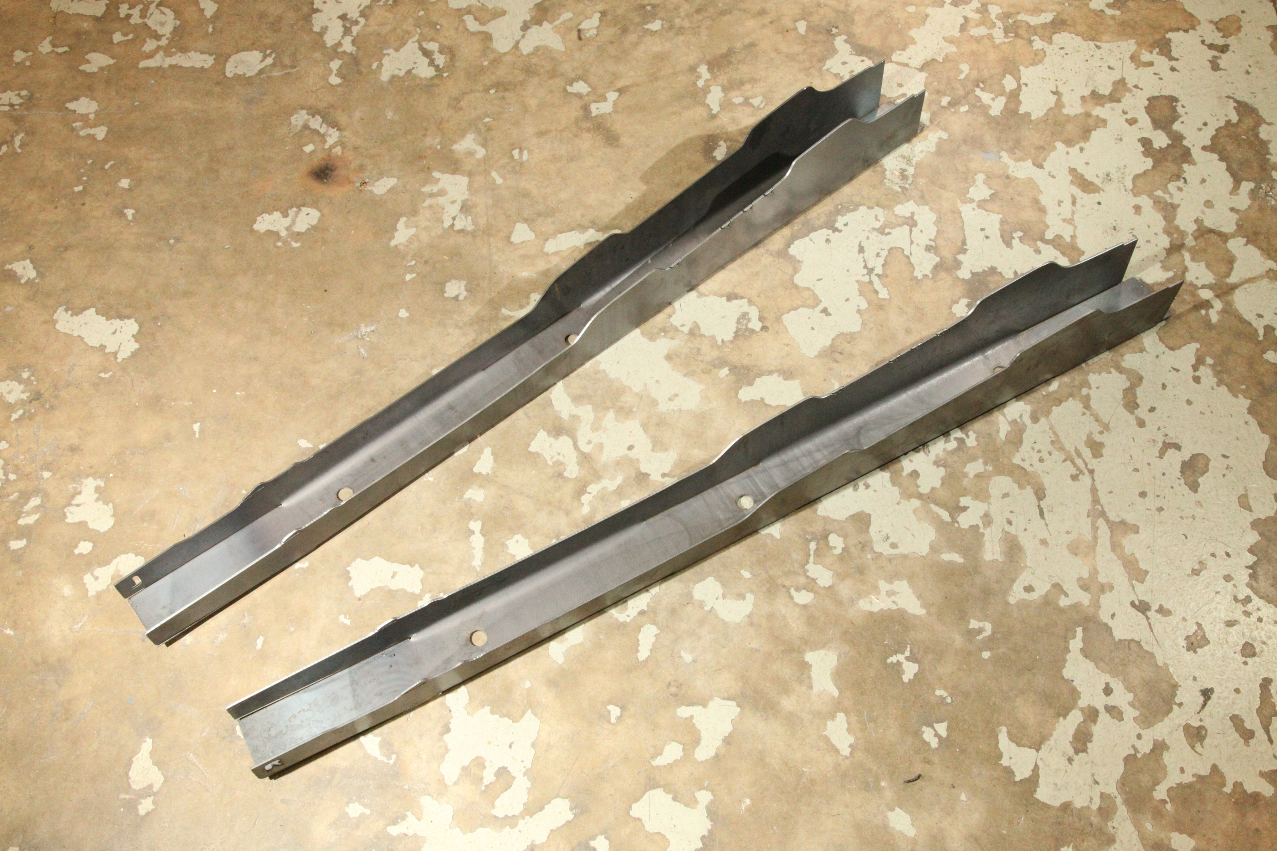 While simple looking, these formed and contoured steel rails are going to transform pretty much all driving-related aspects of our Mopar project, from cockpit noise and road manners, to cornering, braking, and launching. These A-body pieces are made by US Car Tool and sold by Reilly Motorpsorts for $199 a pair. The left and right rails are unique and will only fit one side of the car.
