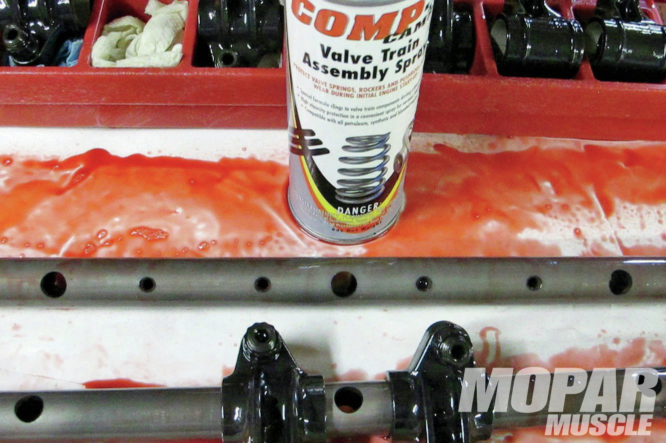 06 For this swap, we would also need to replace the stock, non-adjustable rockers, and upgrade to adjustable units. We chose Comp's Pro Magnum Rocker Arms. Be sure to assemble the rocker arm shaft assembly with the oiling holes facing down when mounting to the head. The entire valve train assembly (shafts, rockers, pushrod ends, valvesprings and tips) were all coated with Comp's Valve Train Assembly Spray—that's the red stuff all over the white plastic.