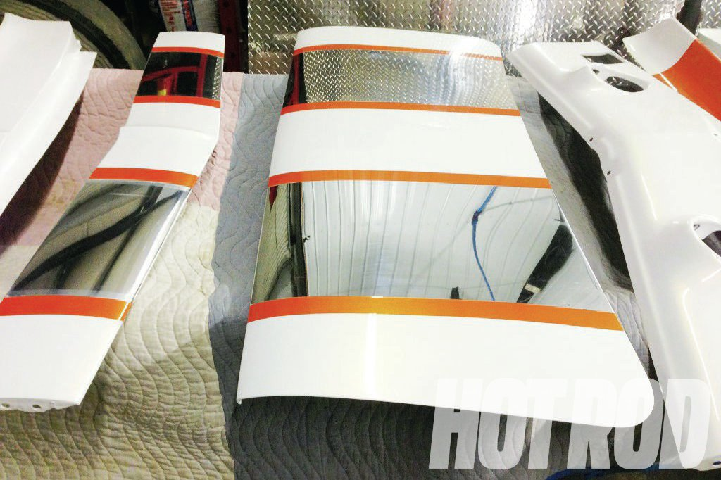 With SEMA just days away, the Auto Metal Direct aluminum panels emerged from the paint booth, freshly sprayed in PPG Pearl White, except for the polished aluminum stripes.