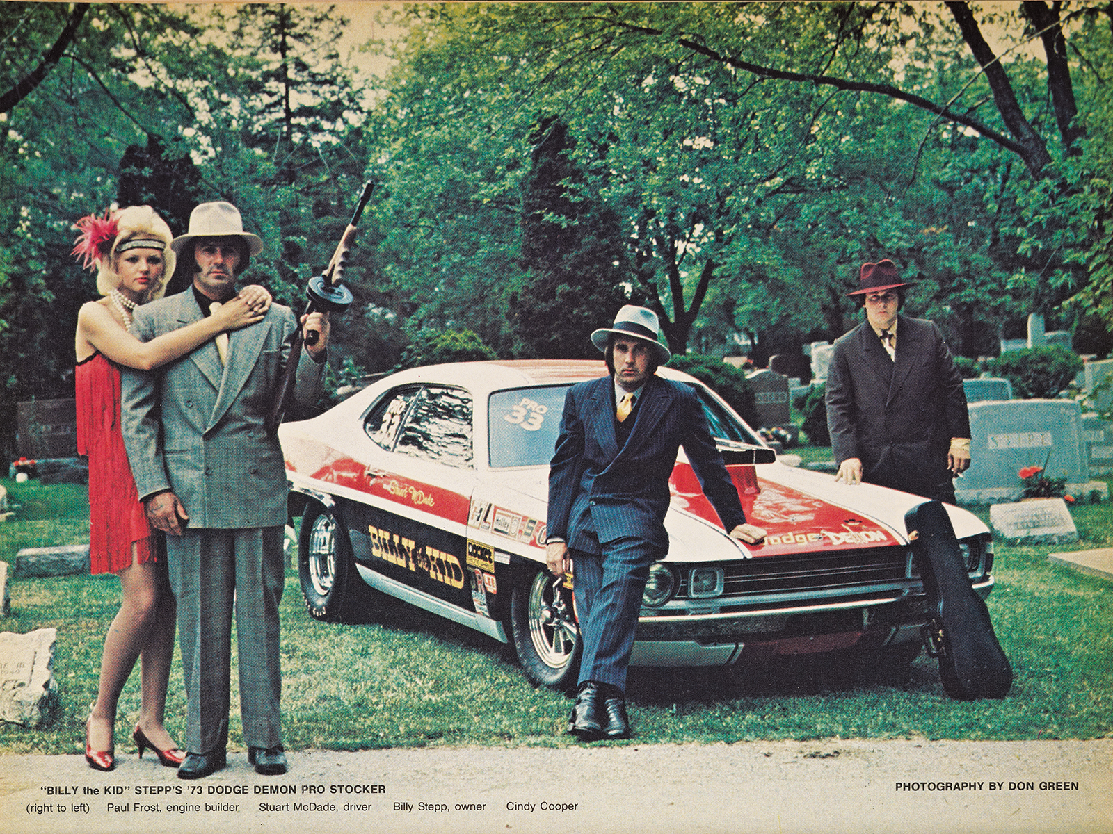 "The Thompson submachine gun was real, and the gangster apparel was authentic when Don Green photographed Billy ""The Kid"" Stepp and his Pro Stock Demon in an Ohio graveyard."