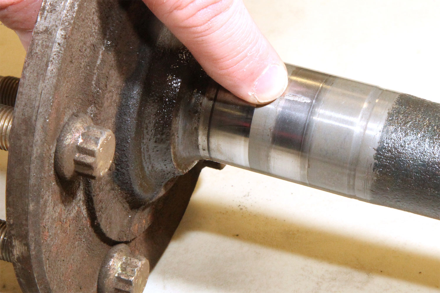 This close-up of the bearing race on our 10-bolt's axle shows a galled spot. If not addressed, the area will spread around the race, taking the temper out of the surface hardening, eventually causing an axle failure. The Timken bearing will move the bearing surface to the smooth area just behind the finger.