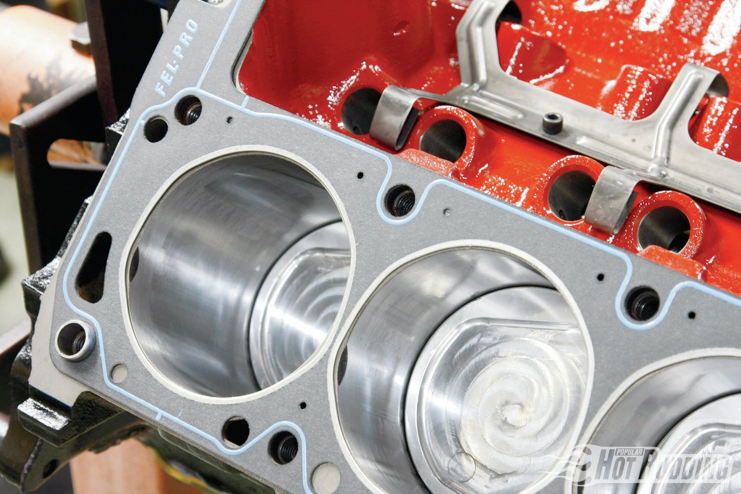 5. Per usual, we're using Fel-Pro head gaskets to ensure an excellent seal to the block. Paired with the 16cc dished Scat forged pistons that sit .010 below the deck, we'll have .060 total combustion chamber volume with the .050 Fel-Pro gaskets.