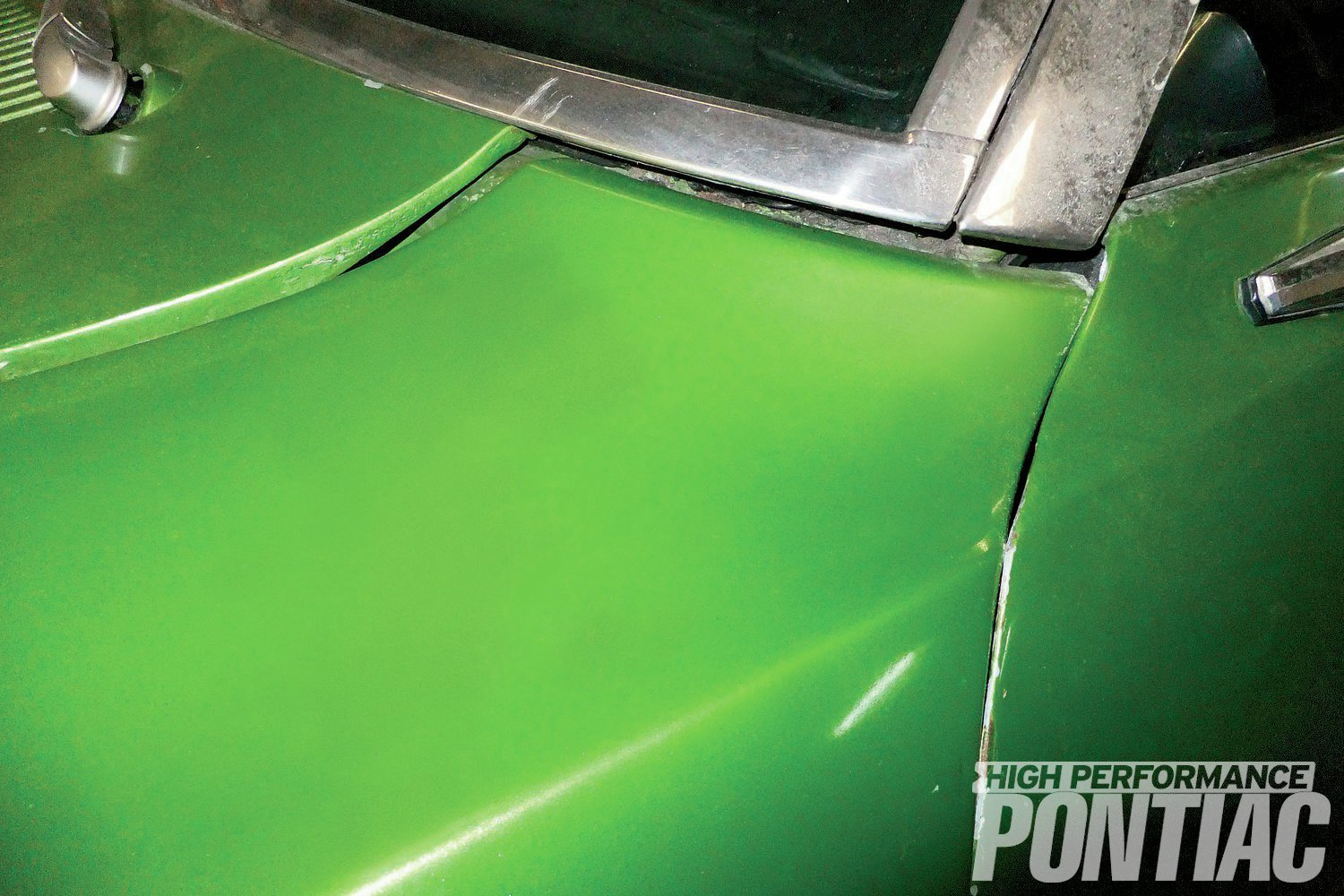 4. The large gap at the cowl panel and the tight gap between the fender and door shows how much the fender has moved both outward and backwards towards the driver-side door.