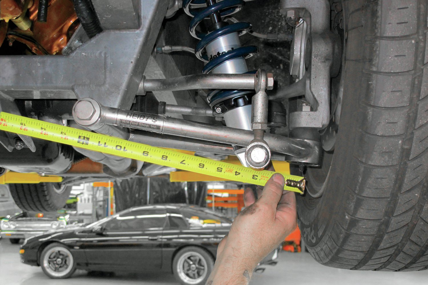 Part of the procedure to determine the motion ratio of an independent suspension is measuring the distance from the centerline of the control arm pivot point to the centerline of the ball joint.