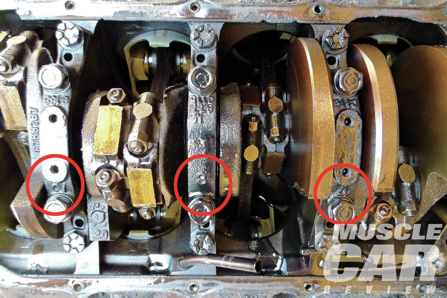 """We dropped the oil pan and rolled the engine over. To our surprise, an engine that was supposed to have two-bolt mains had four-bolt mains! Pontiac's engineering staff had the foresight to mark the location of each cap with its location. All of the caps were removed without any issues. We also noticed that """"ARMA STEEL"""" was cast onto the forward counterweight. General Motors created Arma Steel as a """"super cast iron"""" that was to be used in heavy-duty applications such as rearend housings and performance engine crankshafts."""