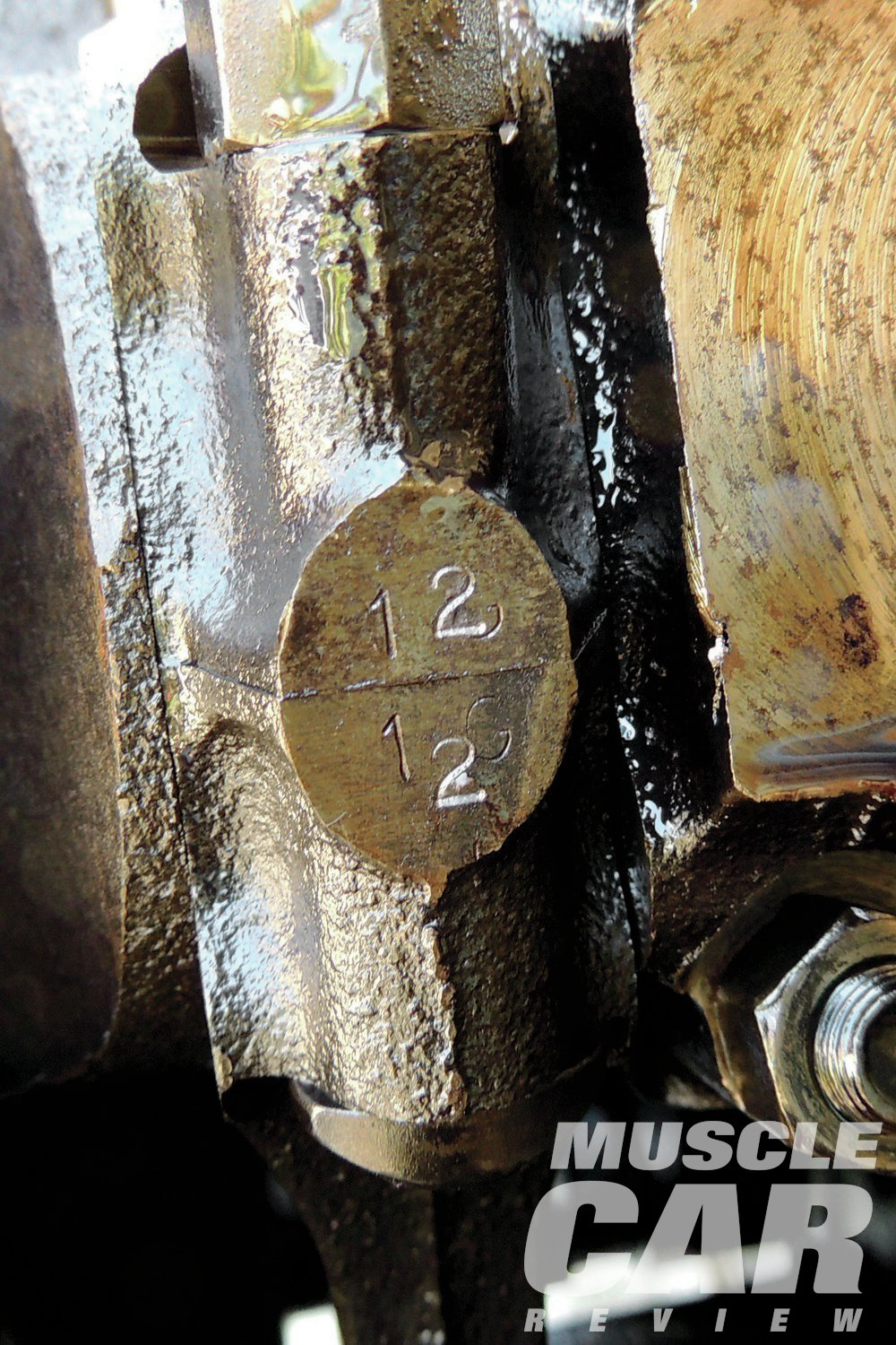 """Pontiac premarked all of the rod caps and rods. Unfortunately, Pontiac's system didn't make any sense. The No. 2 rod and cap were marked """"1G,"""" and the No. 1 rod and cap were marked """"2M."""" We did the traditional stamping from one through eight on the appropriate rods and caps."""