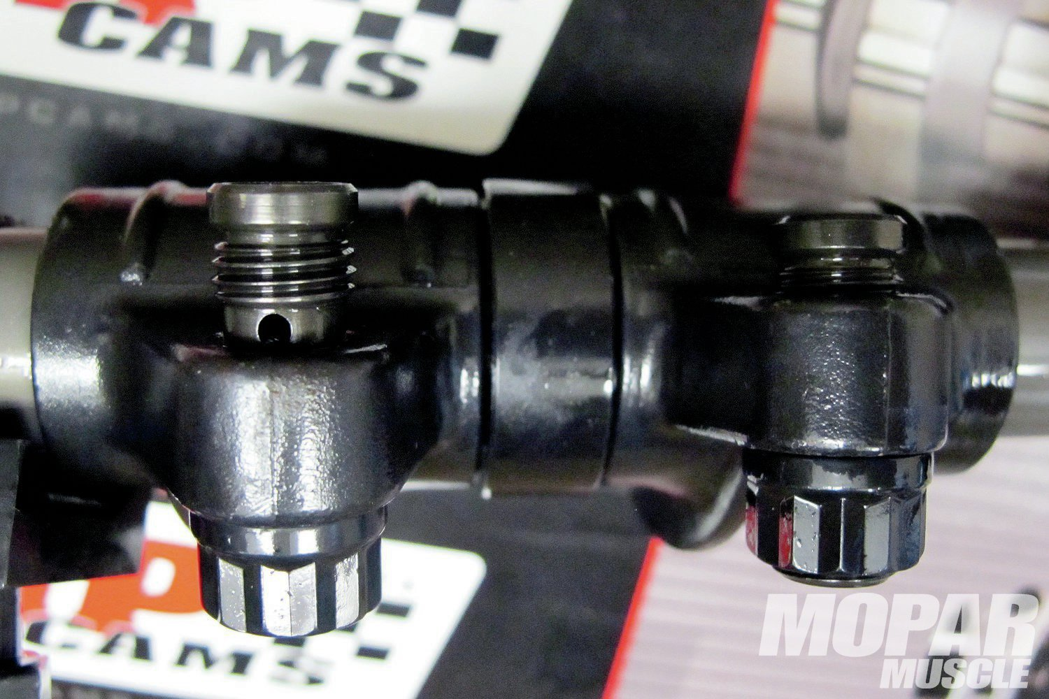 07 Switching from a hydraulic to a solid roller cam will also require different length pushrods, so be sure to measure pushrod length for proper rocker arm geometry. Notice the adjusting screw on the left is showing a thread or two on the bottom and top for proper lubrication to the pushrod and valve tip. With too short of a pushrod, the oiling hole will be exposed. For this build-up along with other RB motors with Edelbrock Performer RPM heads, we've used Comp Hi-Tech pushrods (9.200-inch length) with the Comp Pro Magnum Rockers.