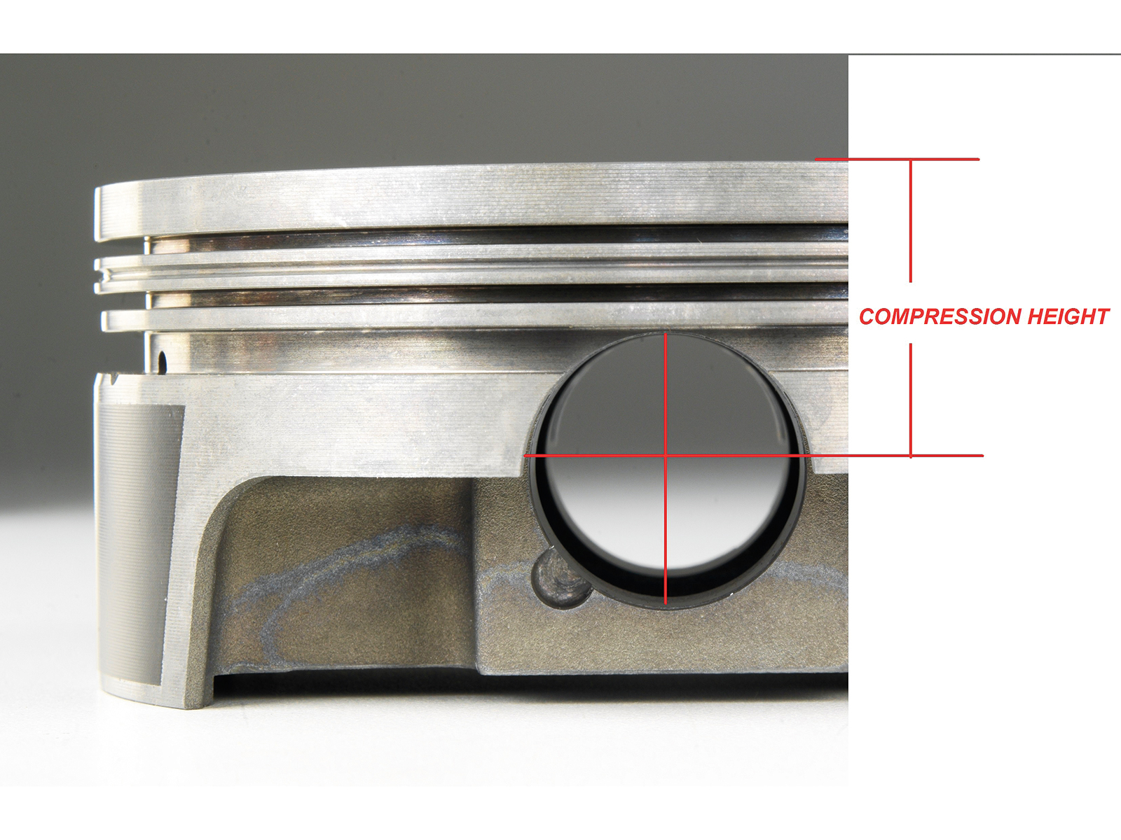"Before selecting your pistons, you will have to know the required compression height so you can get to the actual compression ratio for the engine. Compression height is the distance between the centerline of the wrist pin bore and the top of the piston. When using a flat top piston, this can be simple math. But, add valve notches or a ""pop up"" dome, and now you need to do some math. The dome volume is comprised of the dome (material above the piston's deck), minus the valve notches. This final number will either be a negative of positive. If the volume of the dome is greater than the volume of the notches (typical), then you have a positive dome height."