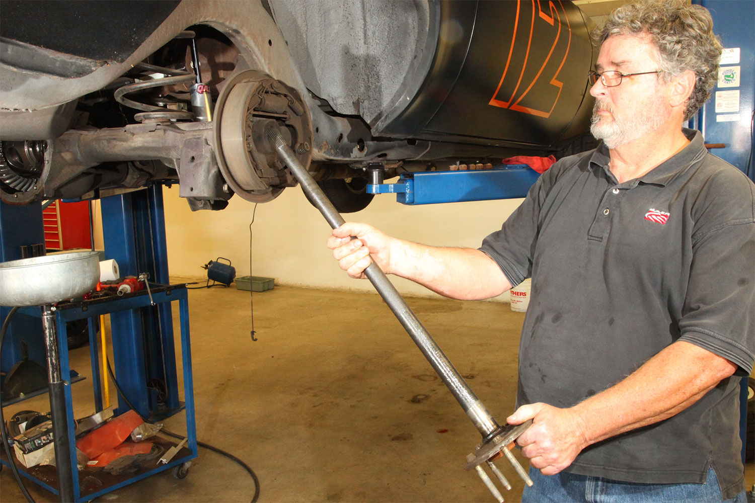 The bearings on our 10-bolt were upgraded while we were at Baer Brakes upgrading the stock drums to Baer's SS4 rear discs. Here, Baer's Dutch Miller shows a trick for removing the stock axle seal. Dutch is using the end of the axle to pry out the seal, which will not be reused.