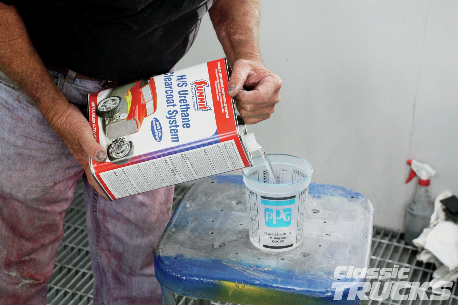 21. Summit Racing's high-solids urethane clear requires no induction time. From the mixing cup it was strained into the gun cup and then it was ready to spray.