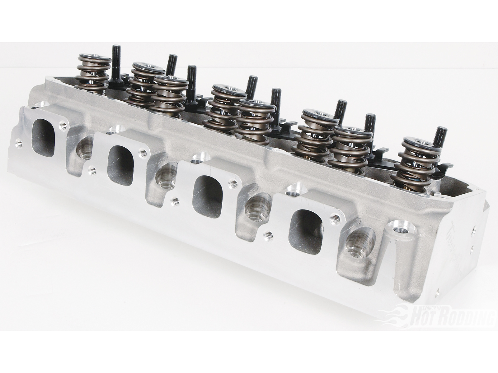 1. Without further ado, these are the Trick Flow PowerPort Cleveland 225 heads (TFS-5161T004-C01, $1,299.99). They feature fully CNC-ported 225cc intake and 115cc exhaust runners and 60cc combustion chambers, and are designed to bridge the gap between the high-rpm slanted Ford 4V heads and the more pedestrian low-rpm 2V heads. They are available bare, or fully assembled like ours.