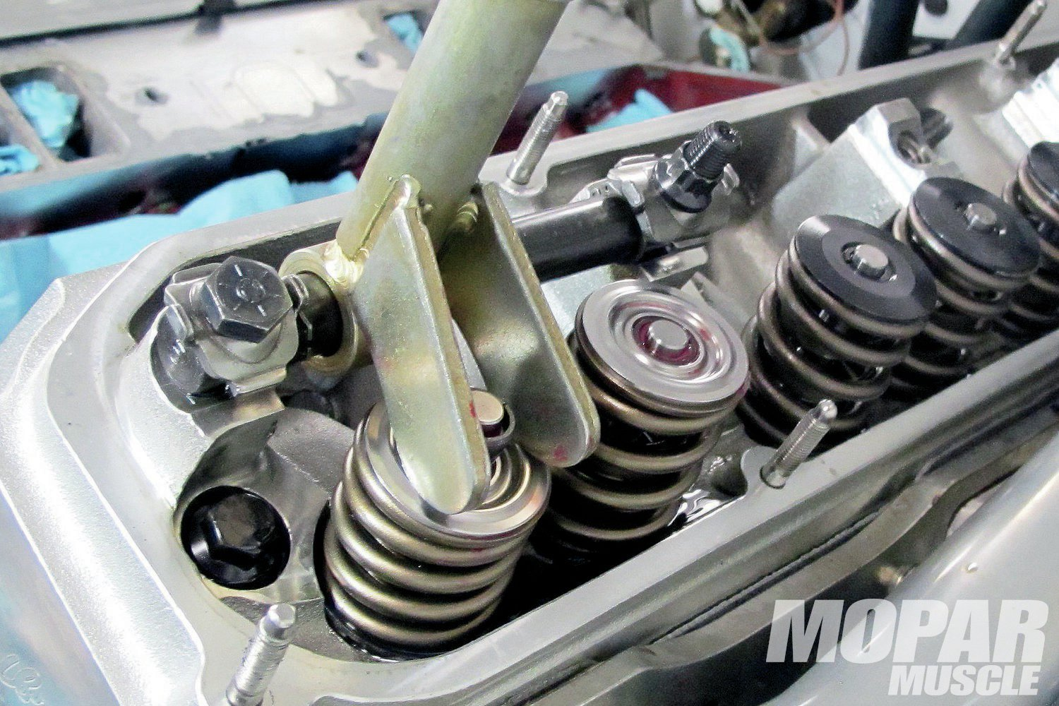 05 This type of swap requires also changing the valve springs. The new springs are set with 148 pounds at 1.900-inch seat load, and 456 pounds at 1.250-inch open load pressure, and were teamed with a lightweight tool-steel retainer for less weight at the valve tip for a faster revving engine and less chance of valve float (bounce). Comp's Extreme Energy and Magnum series solid street-roller cams use valve springs with reduced spring pressure for less valvetrain wear and valve lash change.