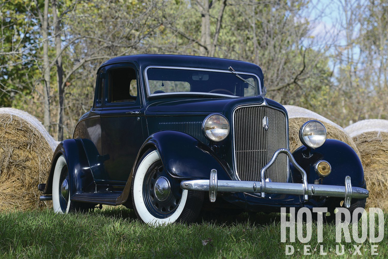 "Bucky bought the 1934 Plymouth in 2011. The one-owner coupe had been sitting since the '60s. ""Lowering it was easy: I cut two coils off the front and made 3-inch blocks for the rear, then put big and little wide whitewalls on it."""