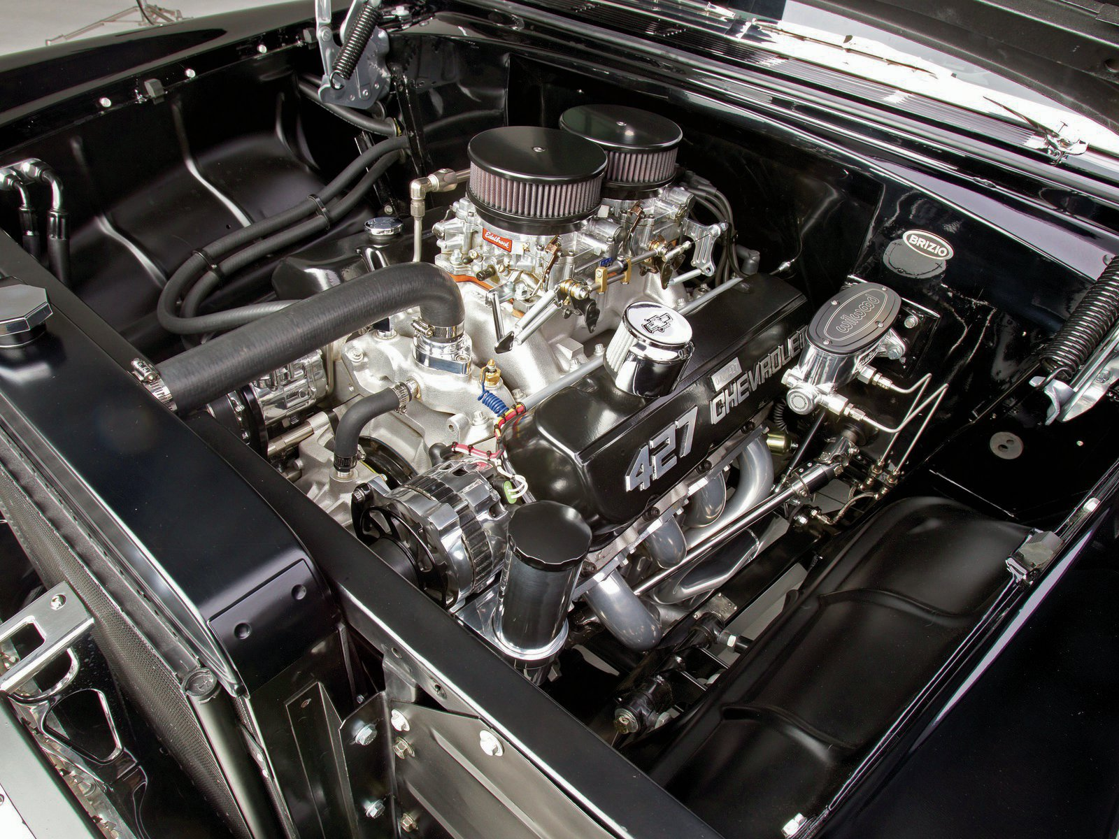 Chevrolet Performance built a limited edition of 427 of the Anniversary 427ci ZL1 engines. Scott and Fred dropped #46 in their '55. With 2x4 carburetion and 10:1 compression, it squeezes out almost 500 hp.