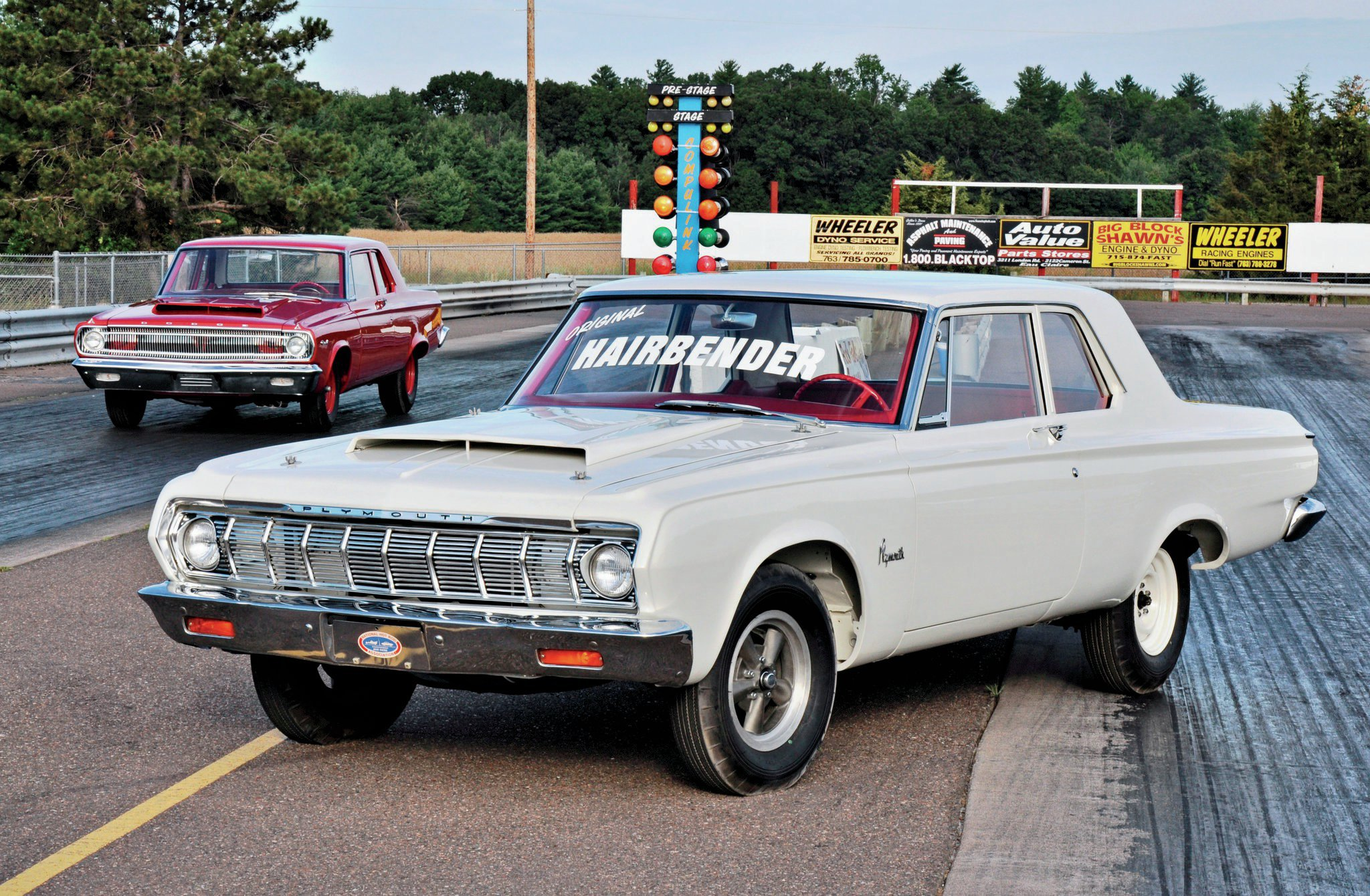 Jim Hale restored the well-known Hairbender, a real-deal '64 Race Hemi Plymouth Savoy. Exact in every detail, this Savoy is a textbook example for any '64 Race Hemi restoration. Behind the Savoy is a '65 Dodge A990 Coronet. Both of these spectacular Hemi cars are owned by Gordon Rohde.