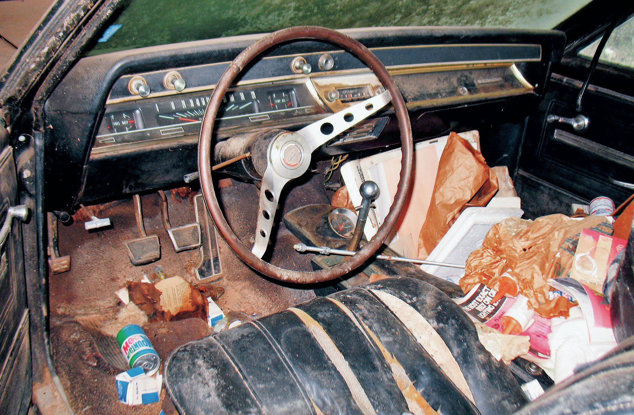 The interior was full of beer cans, spare parts, and odds and ends.