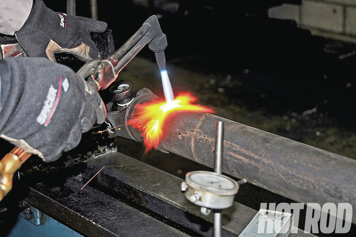 To straighten the driveshaft, the area with the most runout is first heated with a torch, which relieves the stress.