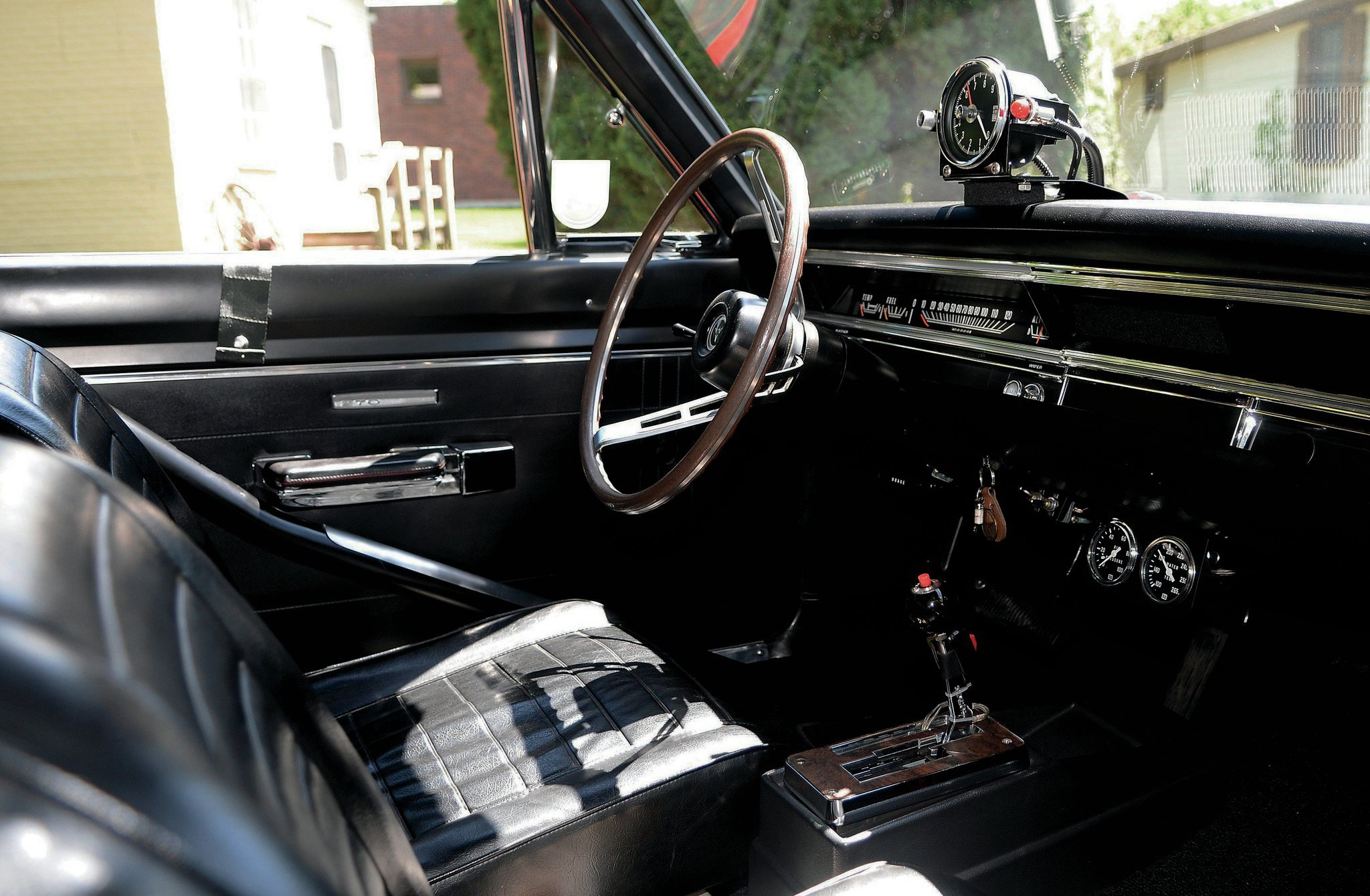 The interior of Daryl's Dart is similar to Dave's, but with two big differences: the factory Hurst Dual-Gate shifter for the TorqueFlite, and the steering wheel, which was originally in Dick Landy's Hemi Dart.