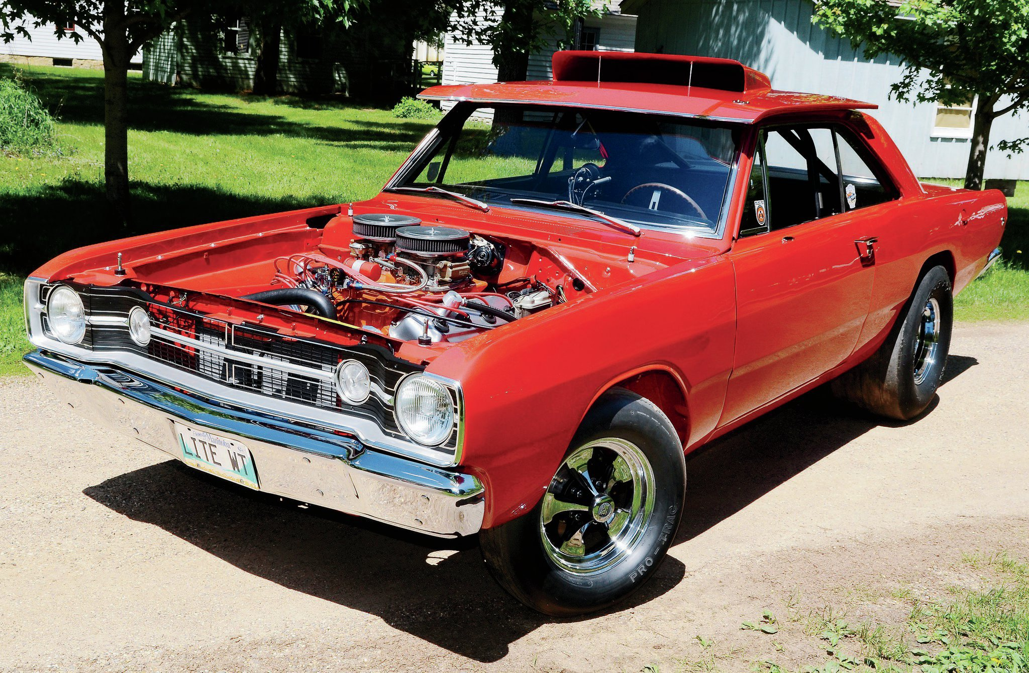 Though the Hemi Darts were intended for competition only, some wound up slugging it out on the streets. Daryl Klassen has taken a former show car and restored it as a fat-tired street fighter.
