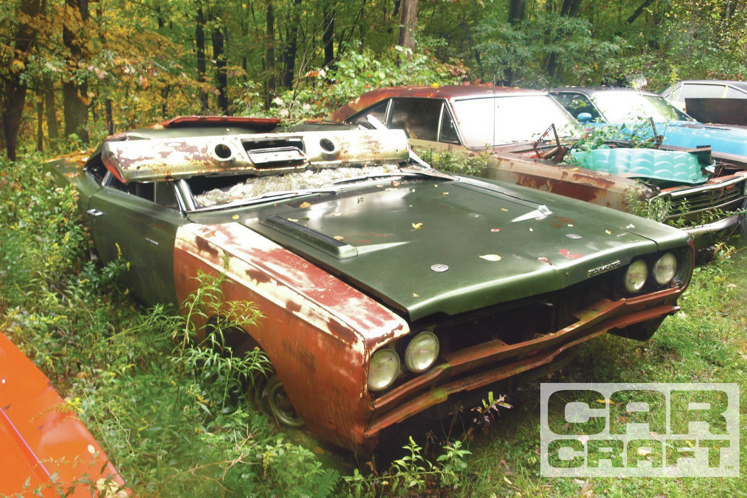 The extra strength of its fixed B-pillars wasn't enough to prevent a years-ago barn collapse from squashing this '69 Hemi Road Runner coupe's lid. Still wearing most of the Ivy Green metallic paint applied at the Lynch Road, Michigan, assembly plant, it is one of 162 pillar coupes built with the 727 Torqueflite transmission. 1969 was the peak year for Road Runner production with 82,109 made. Of them, only 788 buyers coughed up the $813.45 for Hemi power.