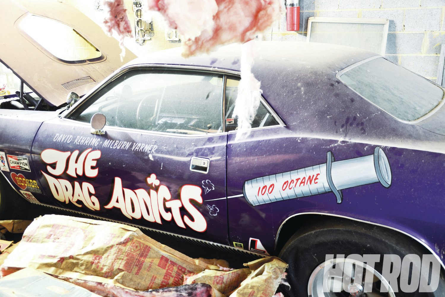 The car's original In Violet paintjob, hand-lettering, and trim are in perfect shape. The slicks are toast because of years of deflation, but the Americans are in pristine condition.