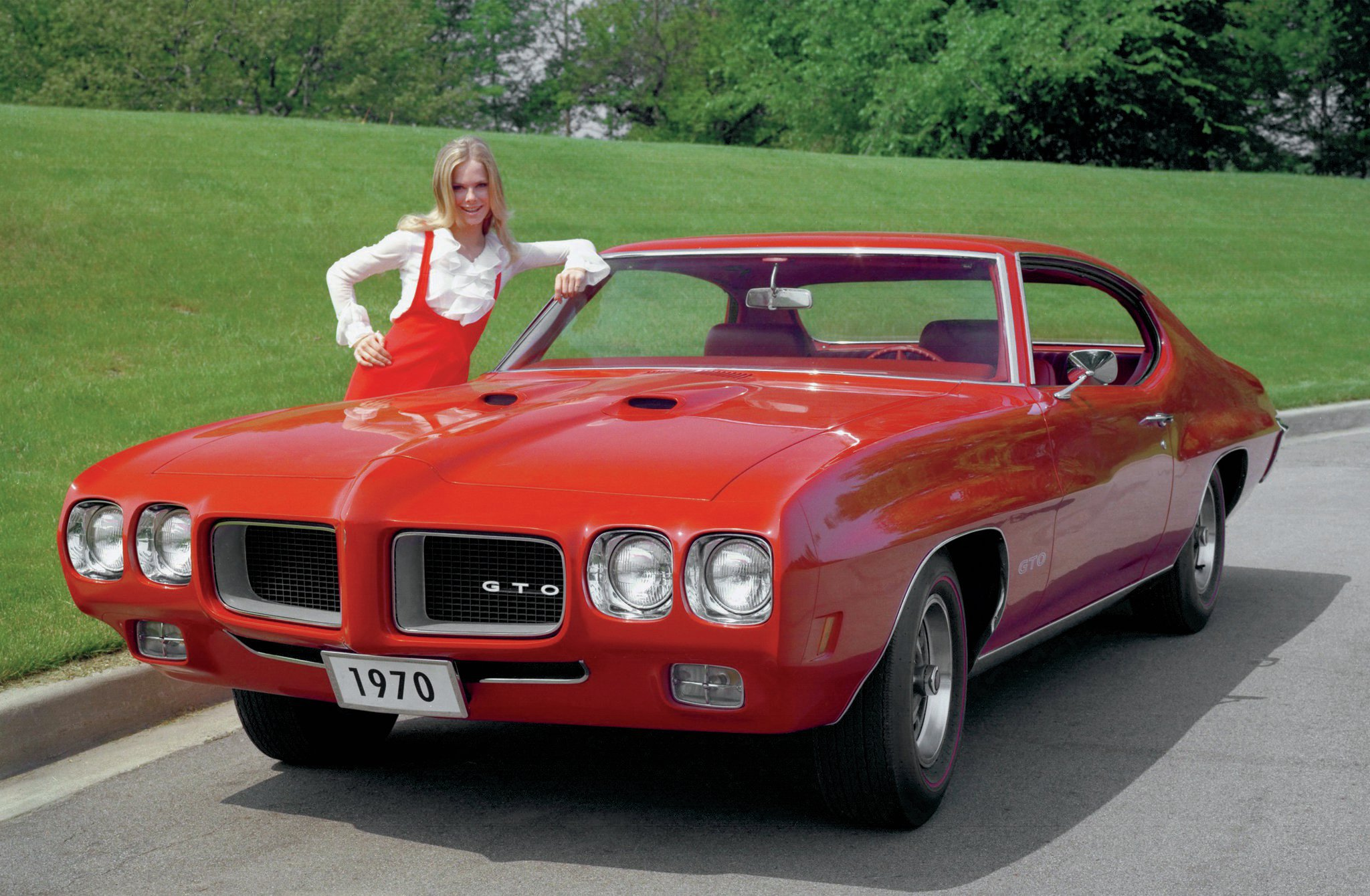 The '70 GTO's styling updates made it one of the most attractive muscle-car designs ever penned. A new Endura nose featured frenched quad headlamps and smaller grille openings. New eyebrow accents over the wheels and a wraparound rear-bumper design gave the GTO an even more aggressive appearance.