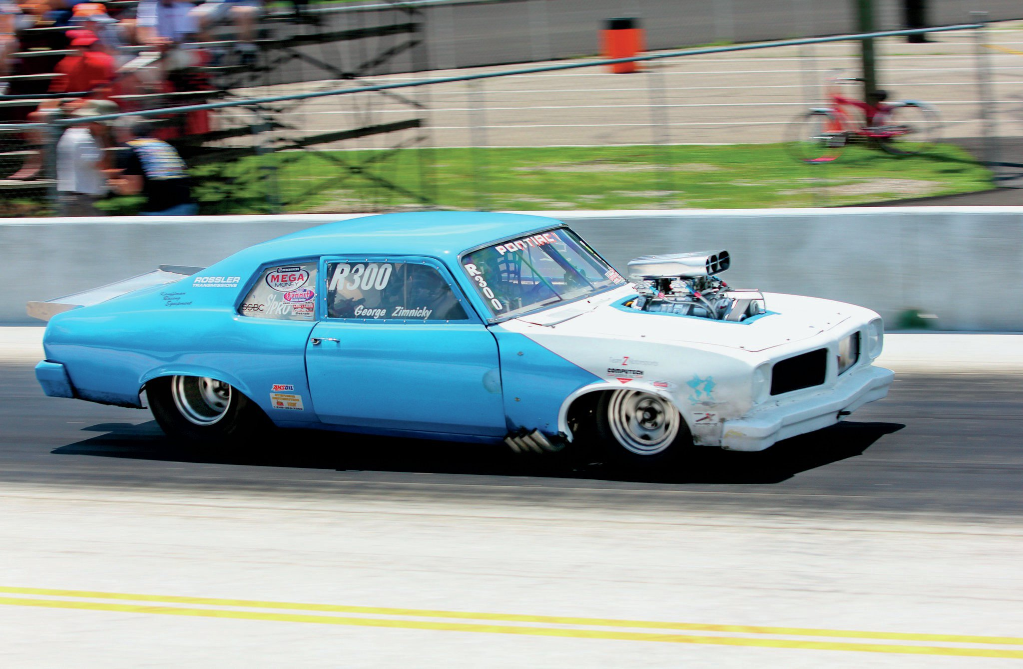 The blown 518ci KRE Pontiac in GTO George Zimnicky's tube-framed '74 GTO shook the ground on every pass. He runs 8.60s at over 153 mph.