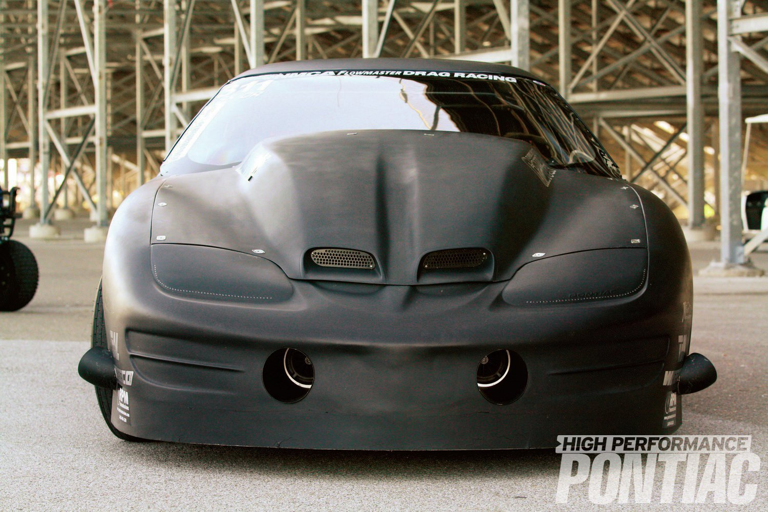 The Trans Am's evil look is set off by a VFN 4-inch, Ram Air, bolt-on, fiberglass hood.