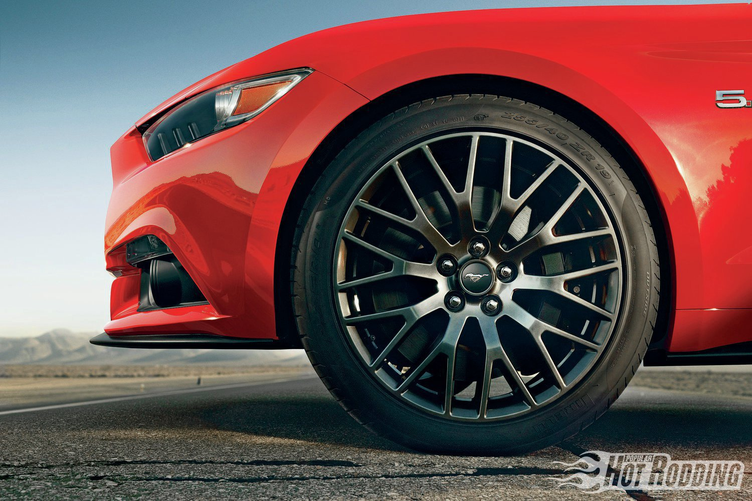 The wheel openings appear perfectly round, as though drawn with a compass, to make the wheels and tires appear even larger. The optional performance package on the V-8 GT includes 19-inch front/20-inch rear wheels, with six-piston brake calipers and 15-inch rotors.